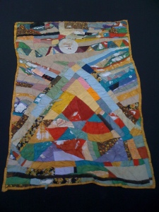 Last pic of this quilt before it it bit the big one. It had multiple layers of fabric in all sections