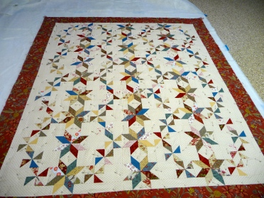 SIL's quilt getting basted on the garage floor..it's super clean, really!